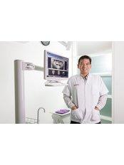 Dr Suchon Pultong - Dentist at Khunchanok Dental Clinic