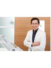 Dr Somchai  Sessirisombat - Dentist at Khunchanok Dental Clinic