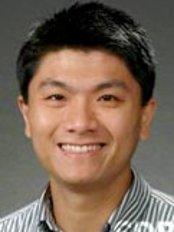 Dr Roongkit Leehacharoenkul - Dentist at Silom Dental Building Clinic, Bangkok