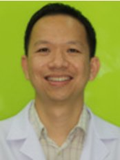 Dental World The Oral Health Center - Dr. Surasak Yowcharoensuk