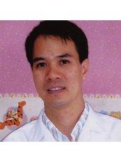 Dr Piya Piyachon - Orthodontist at Funsabai Dental Clinic - Kotchasan Rd.