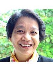 Prof Ratana Umpriwan -  at Grace Dental Care Clinic