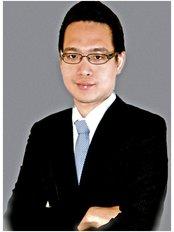Dr Jhong Phitakphong - Dentist at The Dental Design Center