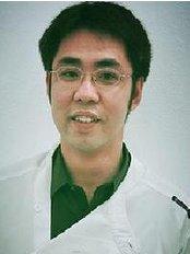 Dr Thanit Pattaraporncharoen - Dentist at A.B. Dental Phuket