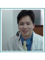 Dr Chatchai Kunavisarut -  at Sea Smile Dental Clinic