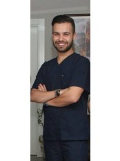 Dr. Sinan Yücel - Zahnarzt - Summer Dental