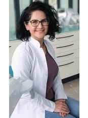 Dr Guliz Onguc - Oral Surgeon at a-dent Dental Clinic