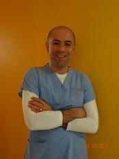 Mr Dr. Dt. Ozgur Evcin - Doctor at Dental Care Med