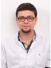 Dr Caner Cetin - Dentist at International Dental  Hospital