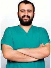 Dr Erdi  Özgül - Dentist at Lara Dental Clinic