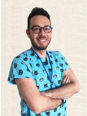 Dr Burak Aksoy - Dentist at Private Panoramik Oral and Denal Clinic - Gulluk Branch