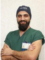Dr Burak Dasdemir - Dentist at Private Panoramik Oral and Denal Clinic - Palm Branch
