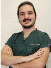 Dr Ahmet Umut Ayraler - Dentist at Private Panoramik Oral and Denal Clinic - Palm Branch