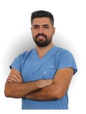 Mr Asım Özden - Dentist at Smile Dental