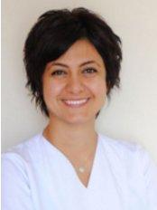 Ozlem Sucu Kurtcebe - Dentist at Sistem Ağız ve Diş Sağlığı Polikliniği - Beylikdüzü