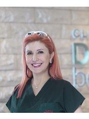 Dr Ferzan Kemali - Dentist at Clinique Dent Beaute