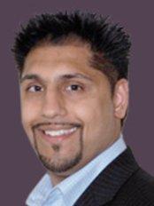 Dr Aman Ruprah - Dentist at CrownWood Dental Practice
