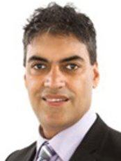 Dr Jaswinder Gill - Principal Dentist at Moonlight Dental Surgery - Shinfield