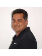Dr Mos Osman - Principal Dentist at Bridge Dental and Implant Clinic