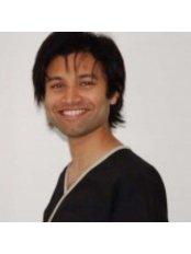Dr Nikhil Arolker - Associate Dentist at Bridge Dental and Implant Clinic