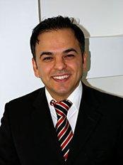 Smile Implant Clinics - Mr M. Pourani