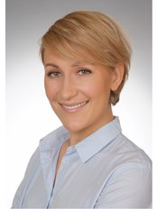 Dr Giedre Lauzikaite - Dentist at Denta Clinic