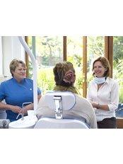Implant Dentist Consultation - Arnica Dental Care