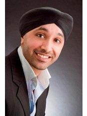 Dr Surinder Bhatti - Oral Surgeon at St. Dunstan's Dental Practice