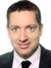 Dr Robert Adams - Oral Surgeon at Carisbrook Dental Care Ltd