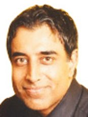Dr Surinder Hundle - Dentist at Ocean Dental Implant and Aesthetic Clinic