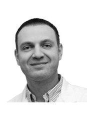 Dr. Sergejs Andrijevskis (Principal Dental Implant Surgeon) - Principal Surgeon at Dental Art Implant Clinic - East Finchley