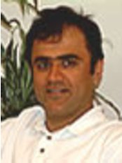 Dr Sanjay Chopra - Oral Surgeon at Highland View Dental Care - Hornchurch
