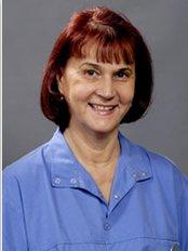 Dr Zsuzsanna Juhász - Dentist at Implantcenter  Dentistry and Oral Surgery