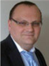 Dr Dr Ramin Kardel - Oral Surgeon at Green Lane Dental Implant Centre