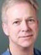 Dr Carl Manhem - Dentist at Green Lane Dental Implant Centre