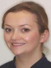 Dr Madeleine Tulett -  at Slade Dental Practice and Implant Centre