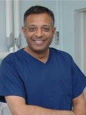 Dr Rash Patel - Principal Dentist at Slade Dental Practice and Implant Centre