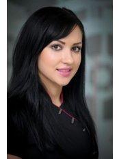 Ms Yuliya Cuc - Receptionist at Queens Gate Dental Practice