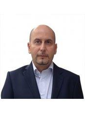 Dr Reza Manbajood - Principal Dentist at Stoke Newington Dental Practice