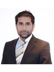 Dr Kamil Ahmed - Principal Dentist at Hermitage Clinic