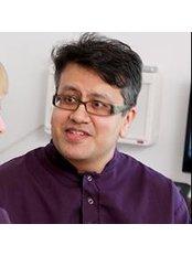 Dr Tamseel Haque - Dentist at Moreton Dental Care