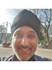 Dr Daljit Sohal - Principal Surgeon at Escentics Dental and Implant Centre