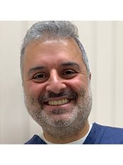 Dr Virendra  Sharma - Dentist at Escentics Dental and Implant Centre