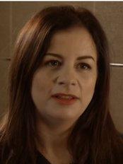 Dr Lisa Godfrey - Dentist at Smilestyle Dental Centre