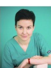 Dr M Tredota - Oral Surgeon at Apex Dental Group - Somerton