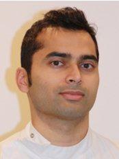 Dr Dipesh Patel - Dentist at Dorking Dental Centre