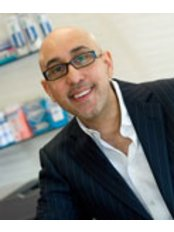 Dr Riz Syed - Dentist at The Mulberry Bespoke Dental Care