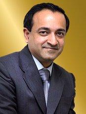 Dr Jim Chirayath -  at Revere Cosmetic Dentists