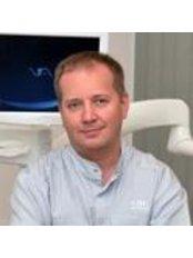 Dr Roman Kuznetsov - Dentist at Silk Dental Clinic in Kharkiv