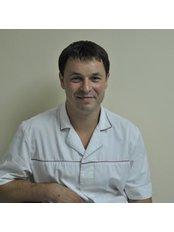 Dr Anton Podorozhniy - Oral Surgeon at Dental Centre Venice